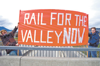 Two young Rail for the Valley supporters on a Chilliwack overpass