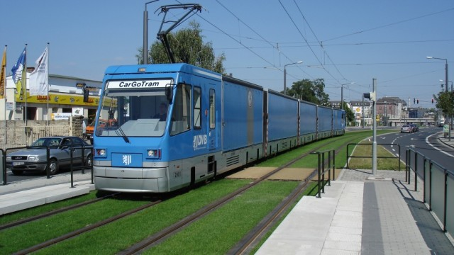 The epitome of modern light rail's flexibility and adapability, a freight tram on lawned R-o-W.