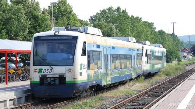 Modern light diesel railcars in operation on a lightly used line in Germany