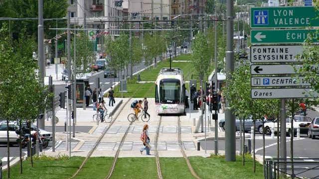 Modern LRT in an urban setting, lawned rights-of-ways, simple yet effective stations, and both user-freindly and non-user freindly.
